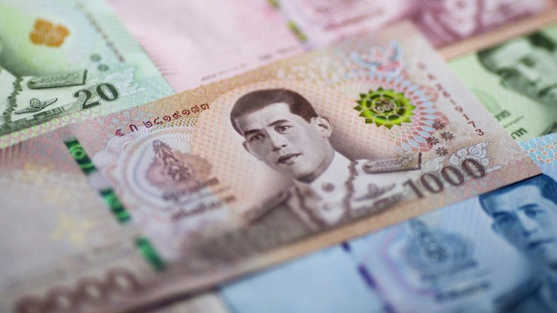 Thai baht lowest since January